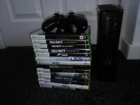 Xbox 360 slim 250 GB with 32 games (14 on disc and 18 on console)
