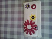ladies cream & flowery purse