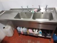 In good condition stainless double sink with taps and waste.