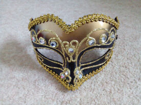 Gold and black mask with headband