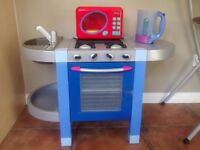 Blue play kitchen with equipment