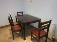dark wood table and 4 chairs - ridiculously cheap for quick sale
