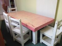 Kids large wooden table and 4 white chairs