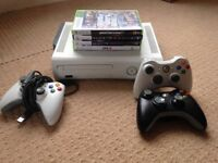 Xbox 360 Console. 60gb HD. 2 Battery Pack Controllers. 1 Wired Controller. 5 Games.