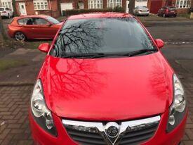 Red Vauxhall Corsa sxi