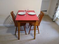 Retro style table and chairs. Excellent for small spaces!