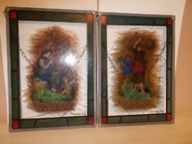 A PAIR OF GERMAN STAINED GLASS RELIGIOUS WALL HANGINGS