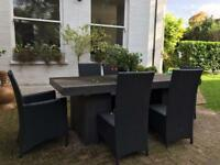 Outside cadix garden table and 6 black rattan type chairs