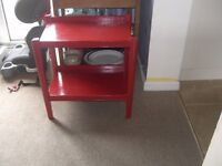 A red painted small table useful as a side table or occasional table