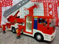 Playmobil fire engine and six crew