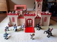 Large wooden fort with figures (knights, horses, wizard etc)