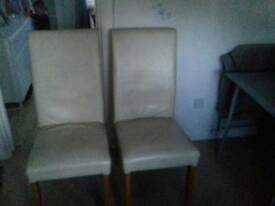 3 cream Lether chairs