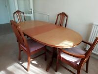Dining table and chairs - teak. RRP £2000