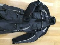 All weather one-piece textile motorbike suit; fully armoured; good condition; ladies size 12/unisex