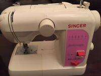 Brand new light weight Singer sewing machine with all accesseries