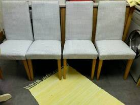 NEXT, SET OF FOUR HIGH BACKED, PADDED DINING CHAIRS, WITH SOLID OAK LEGS