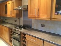 Solid oak kitchen doors and integrated appliances