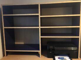 Dark blue book shelves. Lovely condition