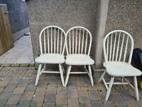3 cream farmhoyse chairs