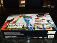 Tightrope Terror GX Racers rides on a line, including GX Racers Vehicle x 1, Line Walker Gyro x1
