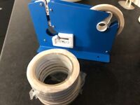 As new bag neck sealer with 8 rolls of tape and clothing tagger inc 1000's of unopened bags