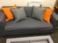 Nearly New - Compact 2-seat sofa KLIPPAN Flackarp grey for sale. Collect only.