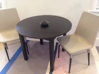 Dining table and chairs, look brand new, just one year-old
