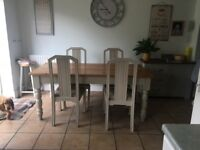 Lovely farmhouse table and four chairs. Large. Sturdy and well made.