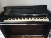 Black Art Deco Minstrelle Piano in need of restoration and retuning