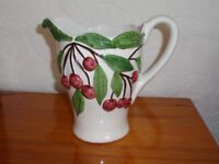 Attractive White Jug with Pink berry detail