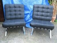 Two black genuine leather Barcelona style chairs