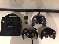 Nintendo GameCube and Three Controllers.
