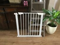 Baby gate for sale. Fix in place then has door opener. Fit minimum gap 31 inch min 34 inch max £10