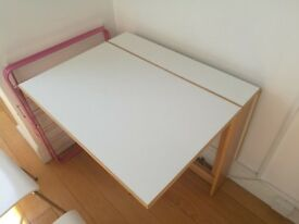 Butterfly dining table in West London