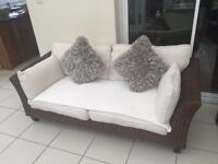 Conservatory Furniture sofa and chair with small leather seat.