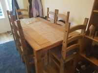 Extendable solid pine dining table & 6 chairs to match