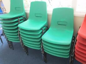 62 green and 11 red stacking plastic chairs