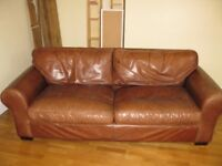 Large 3/4 seater Laura Ashley brown leather sofa