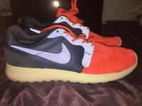 Brand new navy & orange Nike trainers