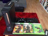 Xbox 360 120gb black plus gears of war 2&3 games