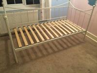 Iron bed, single, cream coloured.