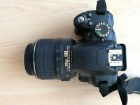 NIKON D3000 with lens and flash