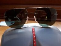 Brand new Prada sunglasses with box.