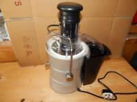 Whole Fruit Juicer - A new Condition (rarely used) Includes Manual.