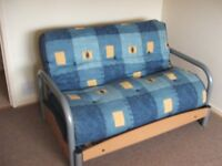 FUTON-STYLE FOLDING BED/SETTEE IN EXCELLENT CONDITION.