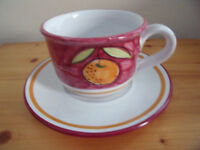 Large hand-painted, brightly coloured, earthenware cup and saucer. £4 ovno.