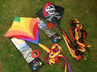 Two children's kites: pirate and rainbow colours- used once, with original packaging.