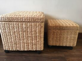 Pair of wicker storage boxes on wheels