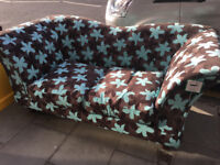 Sofa . New with tags still on . Modern design and fabric. Free Local Delivery.