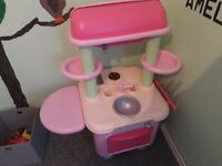 Pink toy kitchen